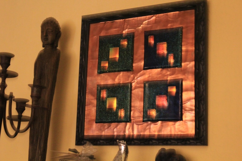 Glass tiles on copper background